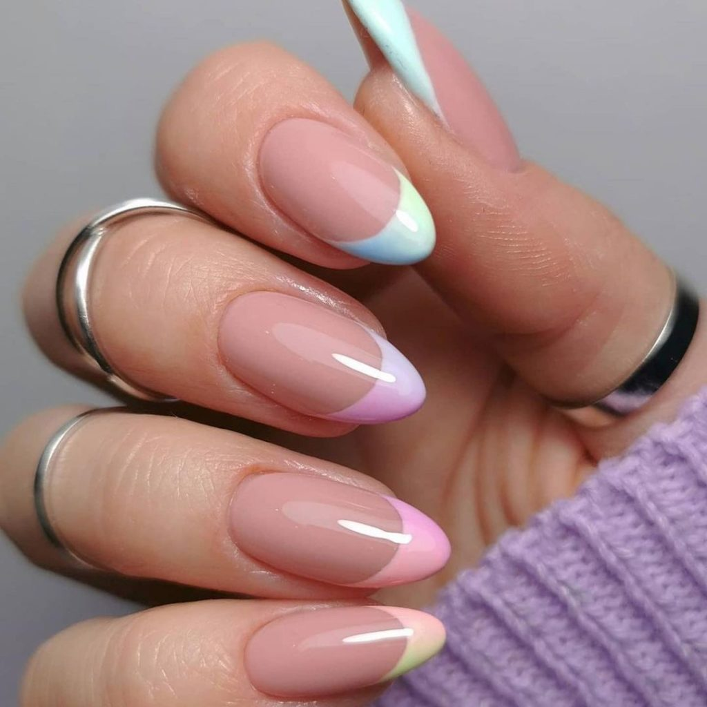 colorful frenchtips on natural short nails with almond shape