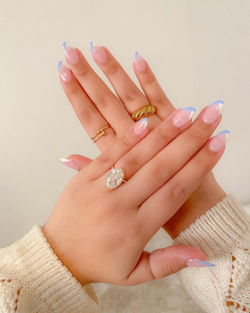 white and blue french mani on short natural nails with almond shape