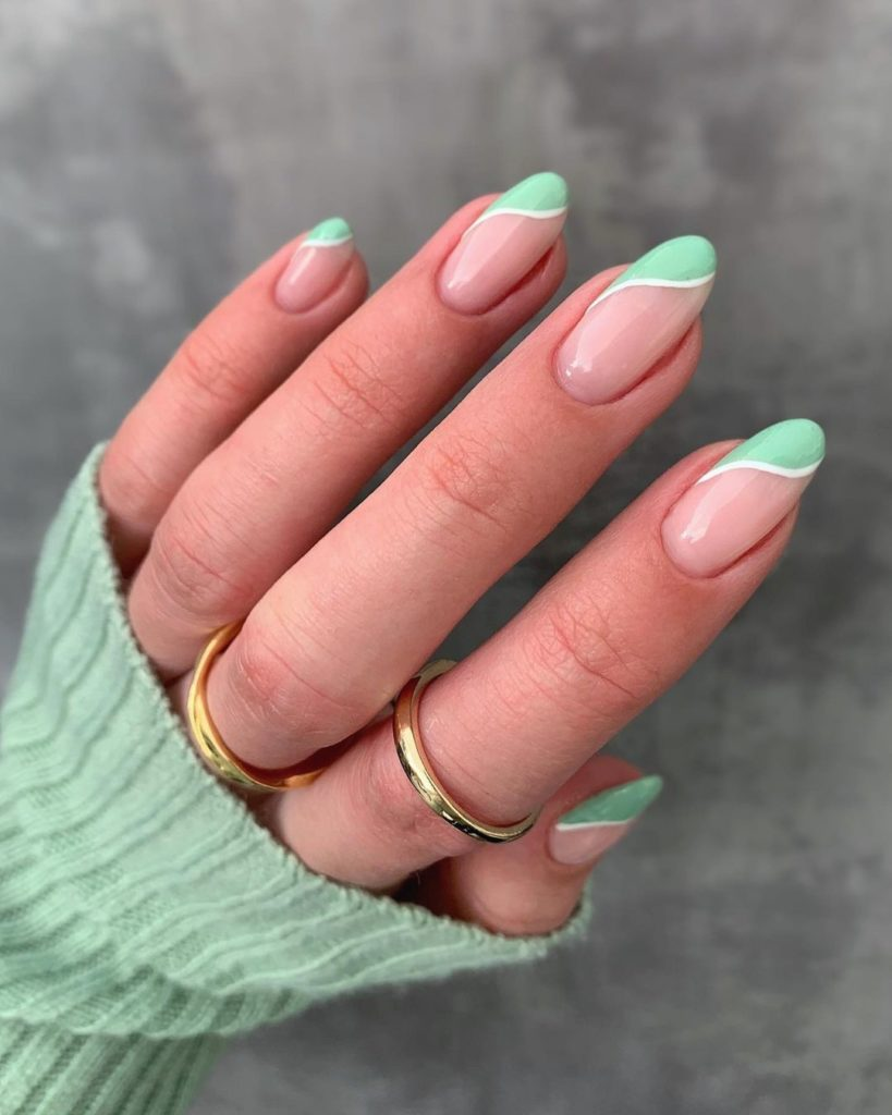 short almond nails with green french mani on side tips