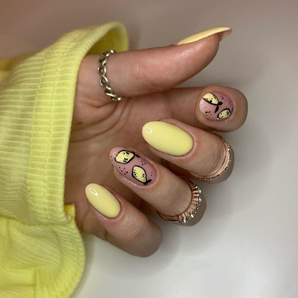 lemon nail art with yellow color on spring nails