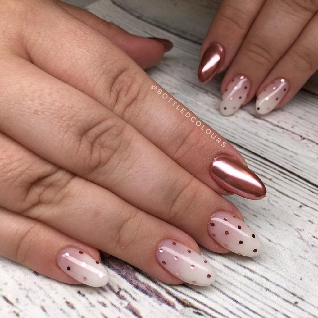 polka dots nail art on gel nails with almond shape