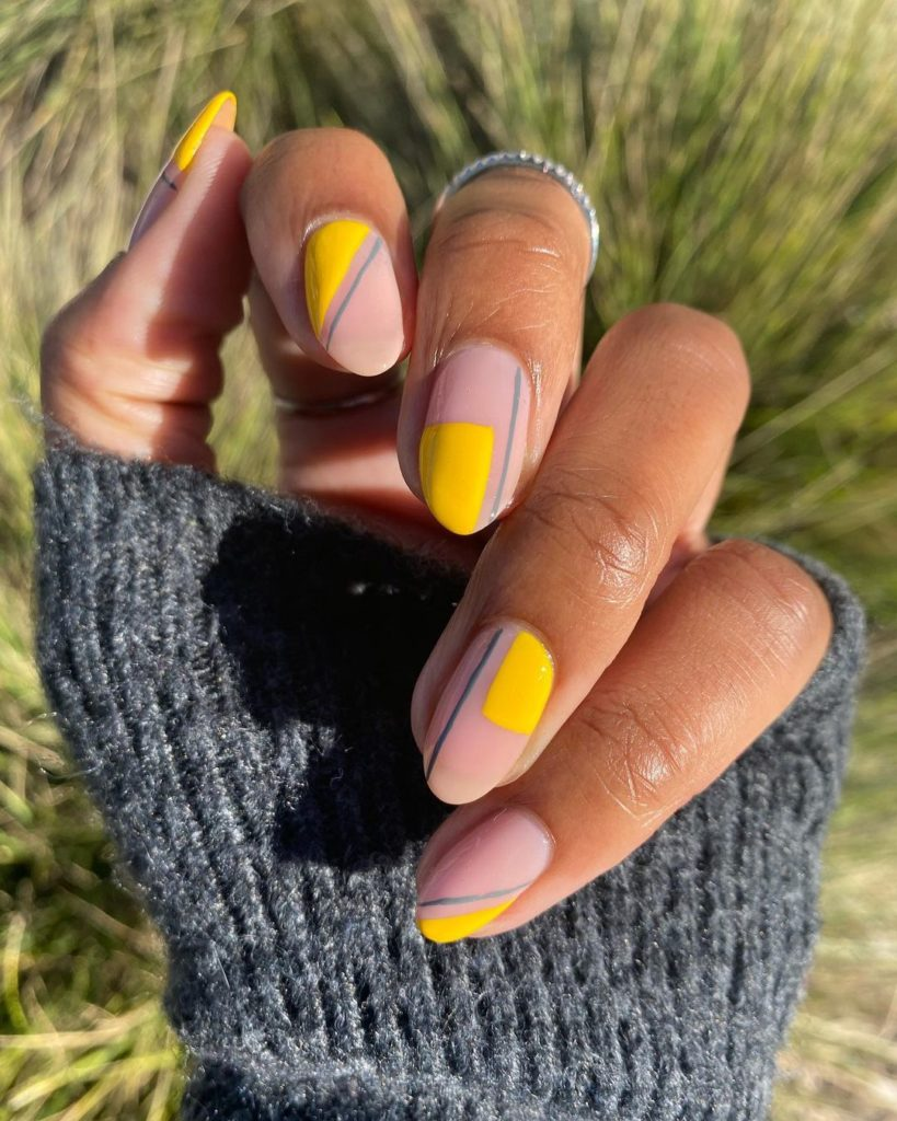 abstract minimalist nail art on almond shaped spring nails