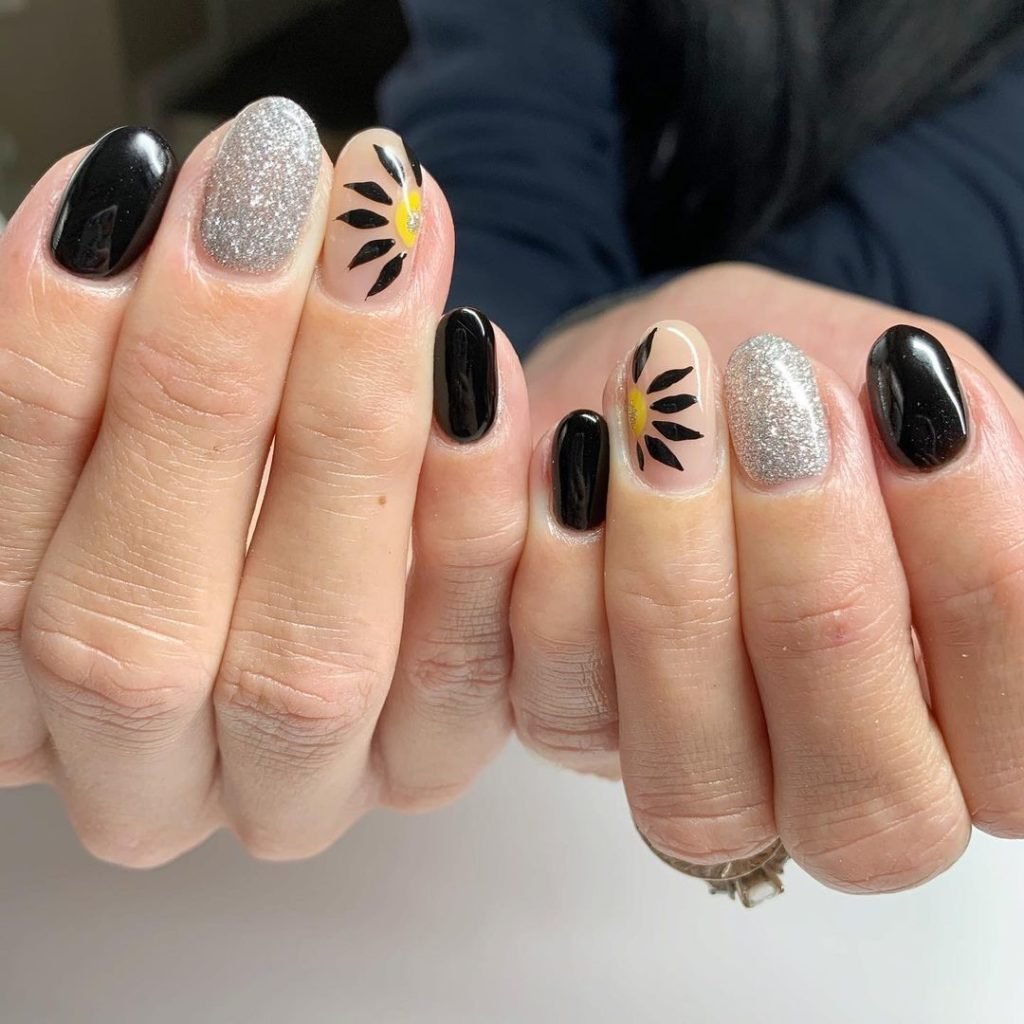 black and silver glitter short nails with sunflower design for spring