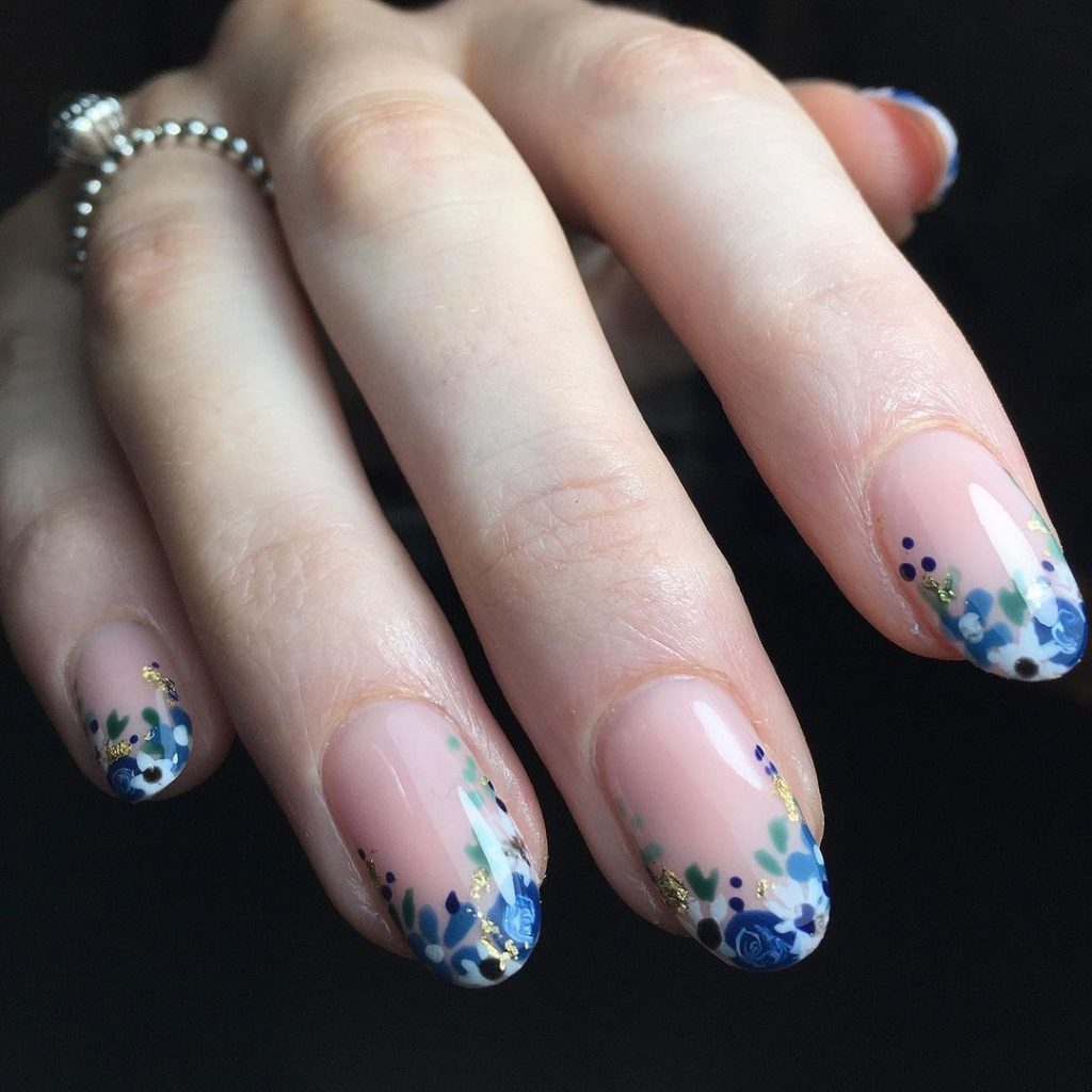blue floral nail art on french tips for spring nails