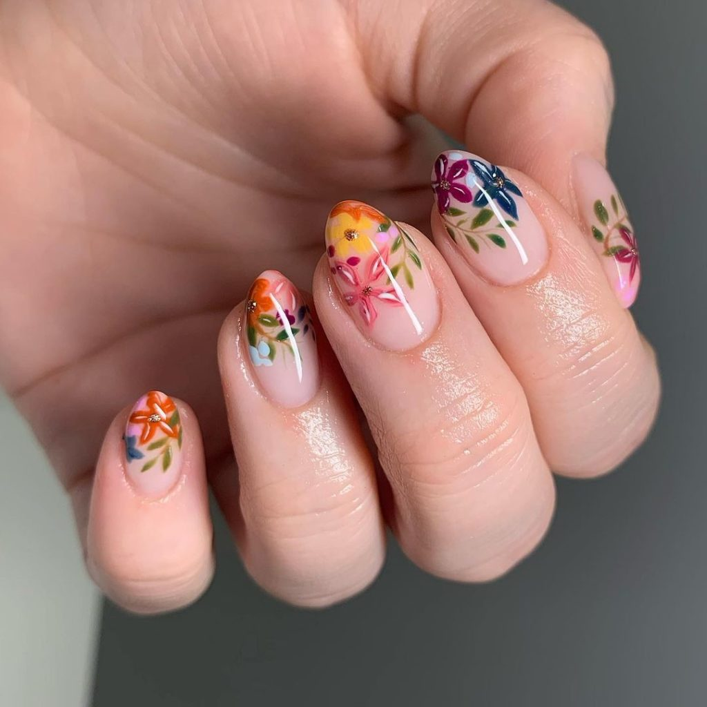 spring nails with colorful floral nail art with almond shape
