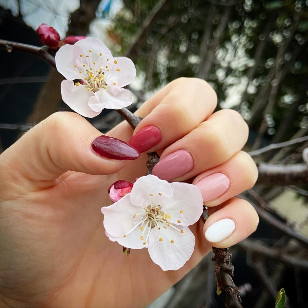 pink skittle spring nails with almond shape