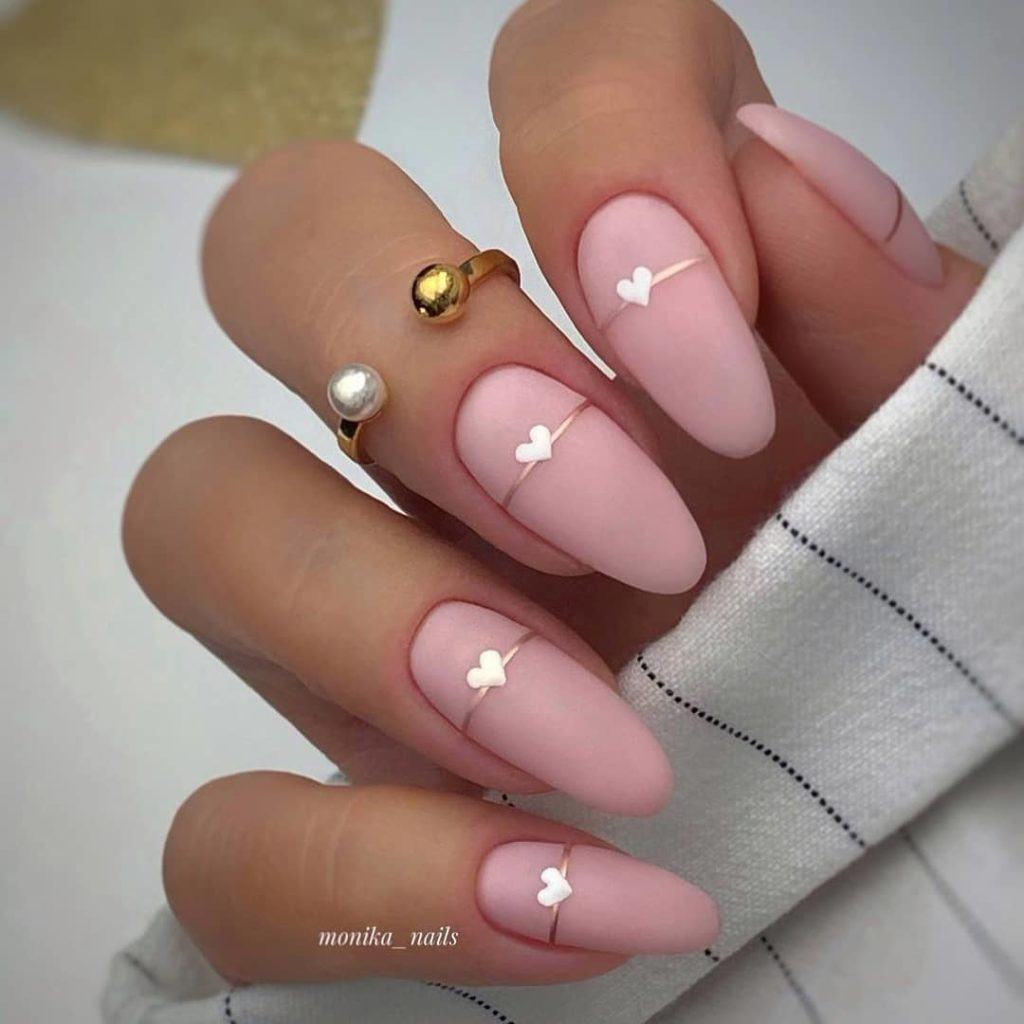 almond shaped matte pink nails with little white heart design